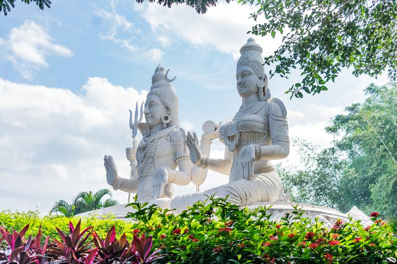 Lord shiv & parvati statue at an indian garden looking awesome with small shrubs. royalty free stock photography
