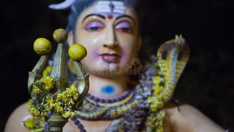 Lord Shiva holding a Trishul in Tiruvannamalai Temple near smash royalty free stock image