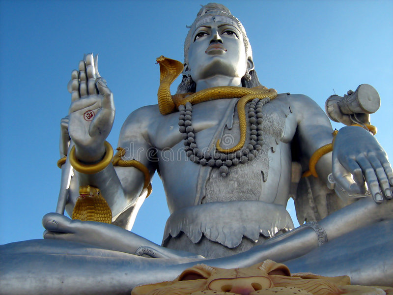 Lord Shiva idol close up. Idol of Hindu god Lord Shiva with blue sky background stock photography