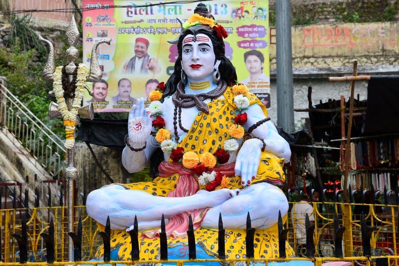 Lord Shiva. An idol of the hindu God Shiva on the banks of River ganga royalty free stock photo