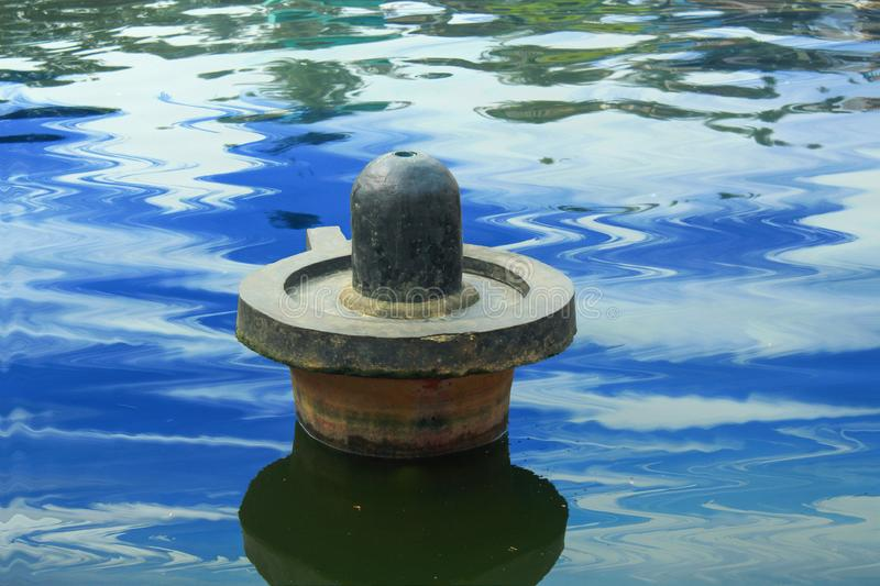 Lord shiva linga in a water stock images
