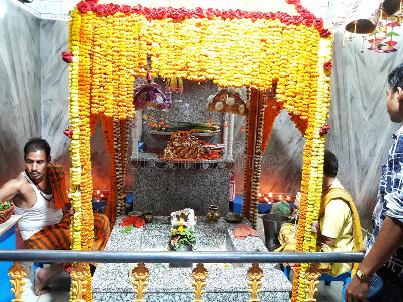 Lord Shiva in a temple during Shivaratri. Cuttack, India, March 04 2019: Cuttack Kedareswar Shiva Temple in the state of Odisha. Indian Hindu monk is worshiping stock photo