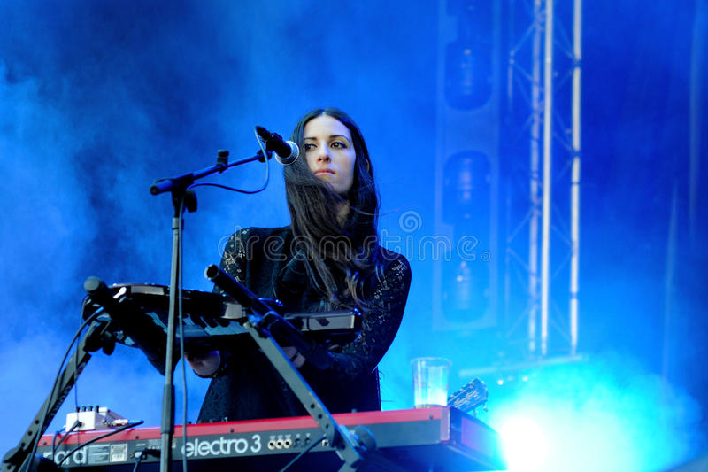 Loren Humphrey, pretty brunette keyboard player of Guards band. BARCELONA - MAY 22: Loren Humphrey, pretty brunette keyboard player of Guards band, performs at royalty free stock images