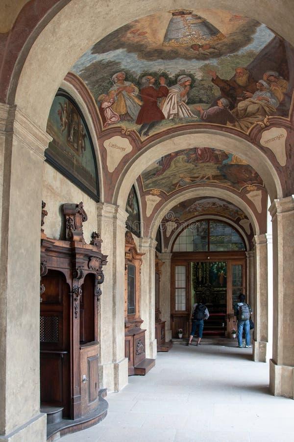 Loreta Prague. PRAGUE, CZECH REPUBLIC, JUNE 21, 2014 - Arcade in courtyard of Loreta Prague - place consisting of a cloister, the church of Church of Nativity stock image