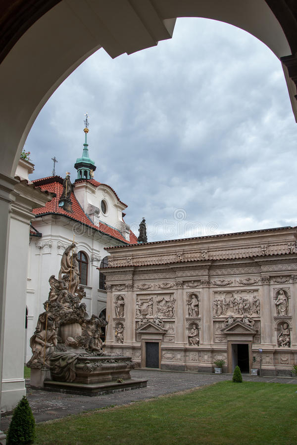 Loreta Prague. PRAGUE, CZECH REPUBLIC, JUNE 21, 2014 - Courtyard of Loreta Prague - place consisting of a cloister, the church of Church of Nativity , Holy Hut royalty free stock images