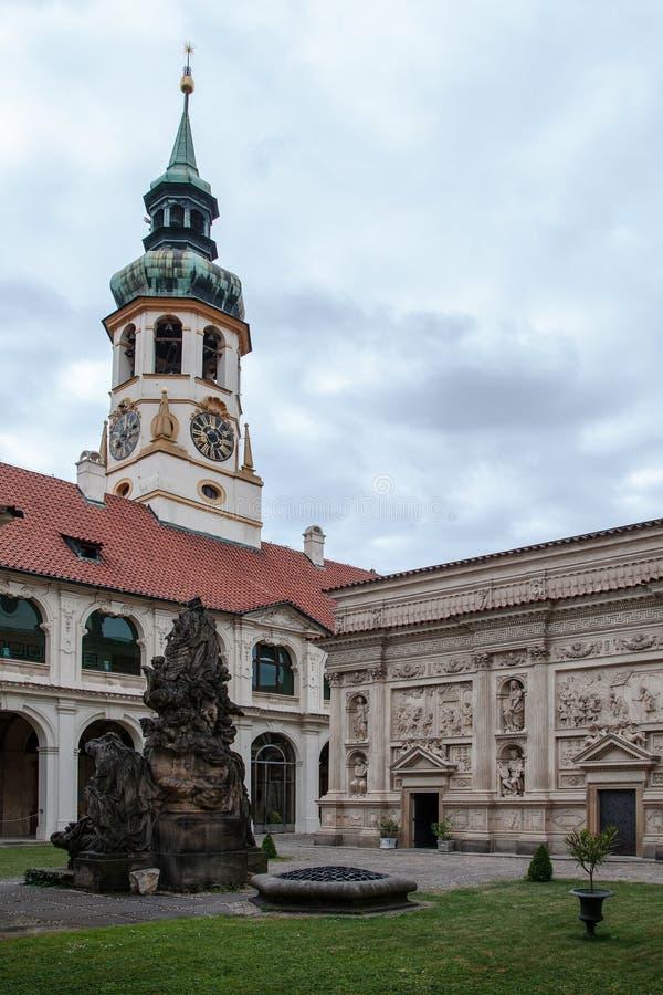Loreta Prague. PRAGUE, CZECH REPUBLIC, JUNE 21, 2014 - Courtyard of Loreta Prague - place consisting of a cloister, the church of Church of Nativity , Holy Hut royalty free stock photos