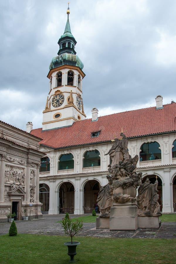 Loreta Prague. PRAGUE, CZECH REPUBLIC, JUNE 21, 2014 - Courtyard of Loreta Prague - place consisting of a cloister, the church of Church of Nativity , Holy Hut stock photography
