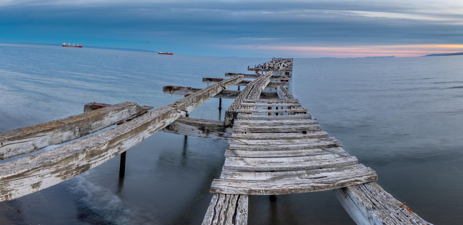 Loreto Pier Bridge at Punta Arenas, Chile. LORETO PIER (1900) - PUNTA ARENAS - CHILE in magellan strait, bird, landscape, latin, america, nature, south stock image