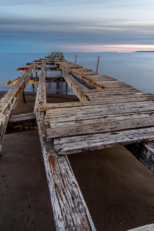 Loreto Pier Bridge at Punta Arenas, Chile. LORETO PIER (1900) - PUNTA ARENAS - CHILE in magellan strait, bird, landscape, latin, america, nature, south stock photography