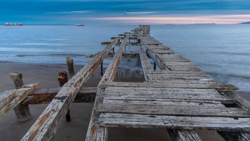 Loreto Pier Bridge in Punta Arenas, Chili stock afbeelding
