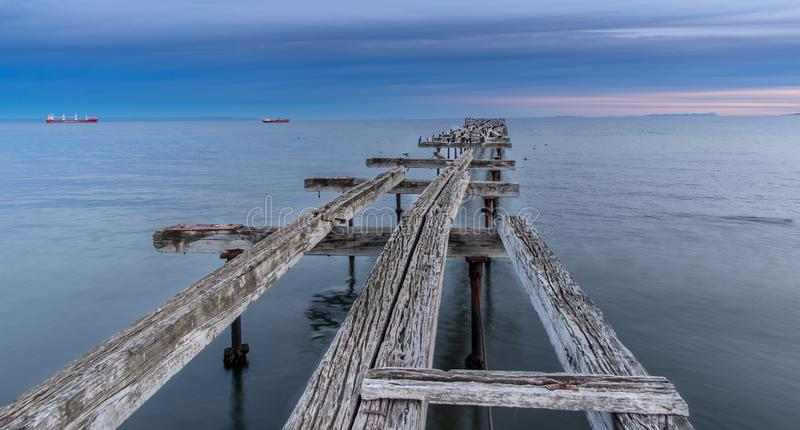Loreto Pier Bridge in Punta Arenas, Chili stock foto's
