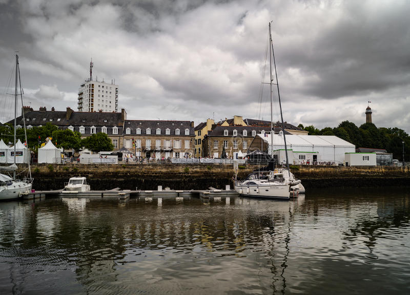 Lorient port quay with sailboats and houses royalty free stock photo