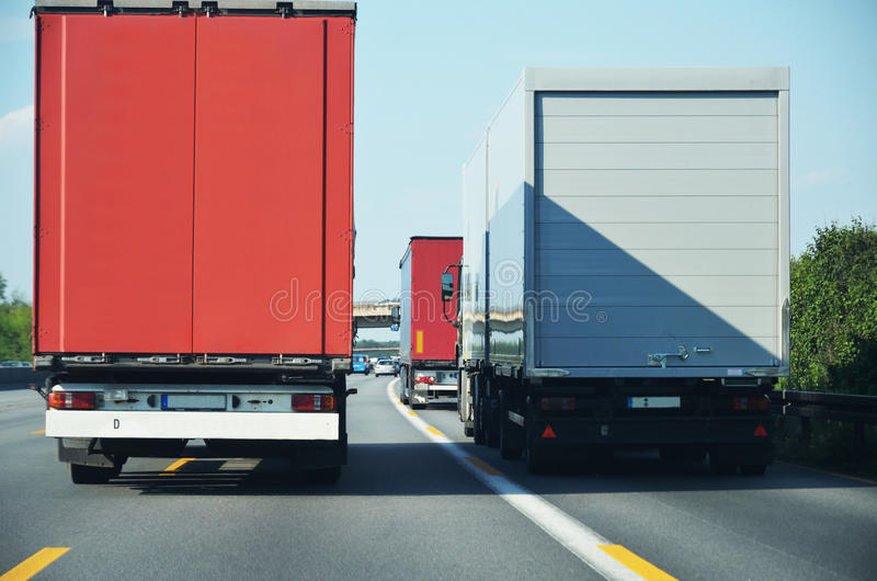 Lorries overtaking one another. On motorway stock photos