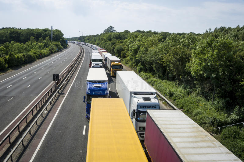 Lorries Parked on the M20 in Operation Stack. Operation Stack is in place on the M20 on the hottest day of the year, due to the Port of Calais being closed stock image