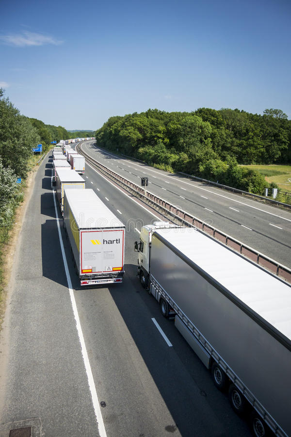 Lorries Parked on the M20 in Operation Stack. Operation Stack is in place on the M20 on the hottest day of the year, due to the Port of Calais being closed stock photography