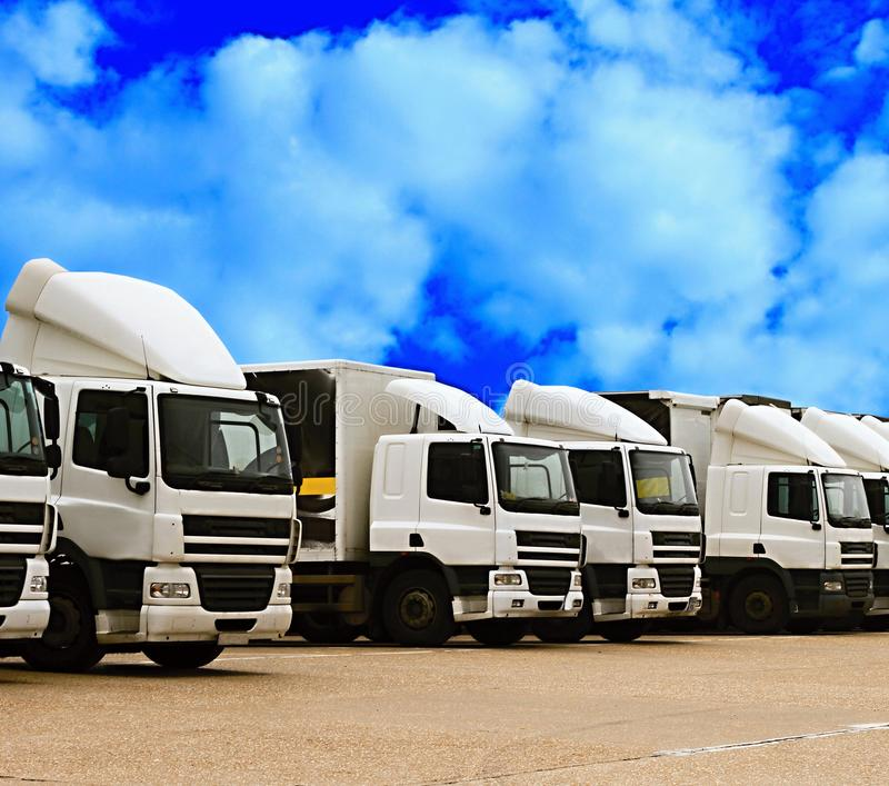 Lorries parked up outside a company. `s car parking area ready to deliver goods to customers royalty free stock image