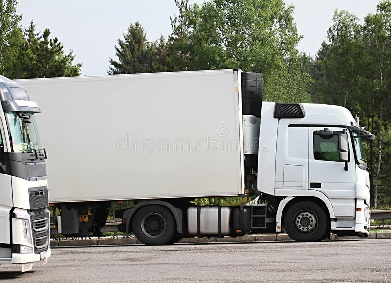 Lorries parked up outside a company`s car parking area. Image of lorries parked up outside a company`s car parking area royalty free stock photography