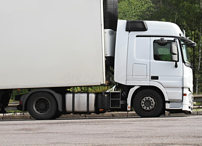 Lorries parked up outside a company`s car parking area. Image of lorries parked up outside a company`s car parking area royalty free stock photos