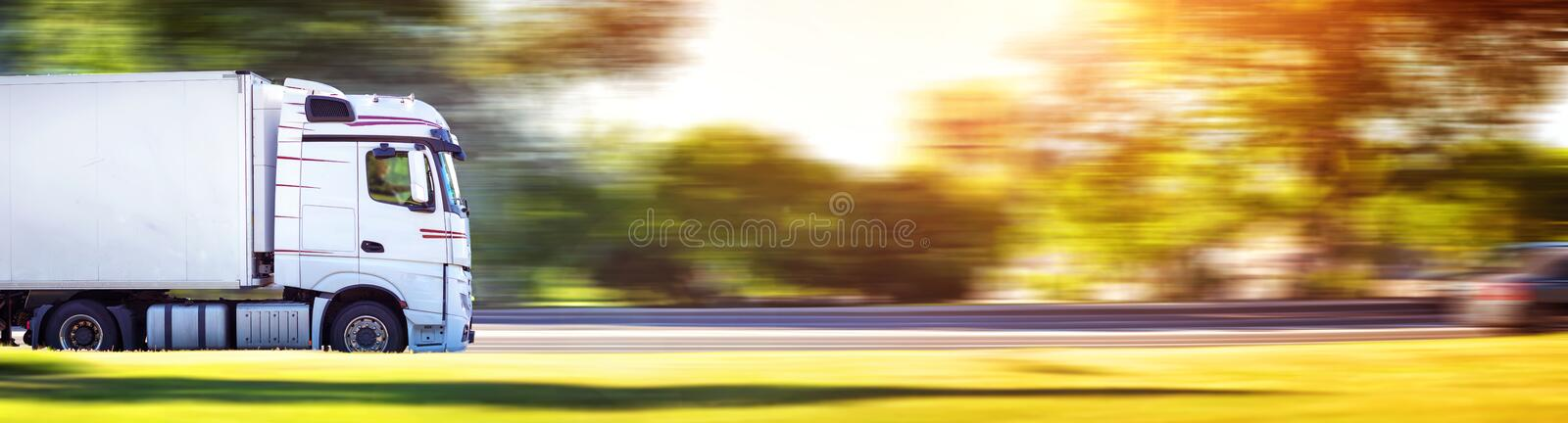 Lorry moving on sunny evening stock images