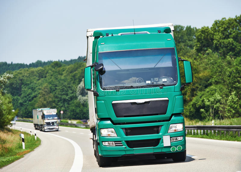 Lorry moving with trailer on lane. Logistic lorry truck with trailer driving on lane road delivering goods stock photography