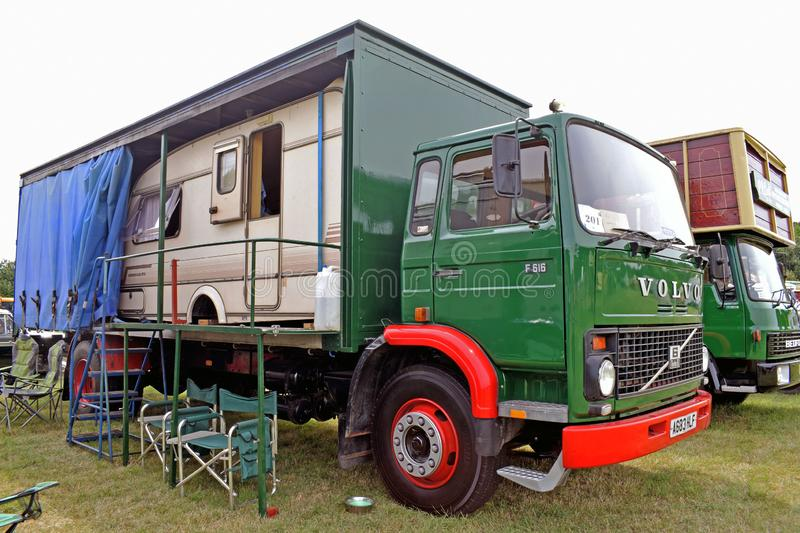 A lorry with a small caravan inside the trailer on the back royalty free stock photography