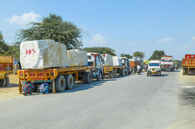Lorry transports huge marble stones. PADANGANJ, INDIA - OCTOBER 21: lorry transports huge marble stones from the pit on highway 7 to resellers all over india on stock photography