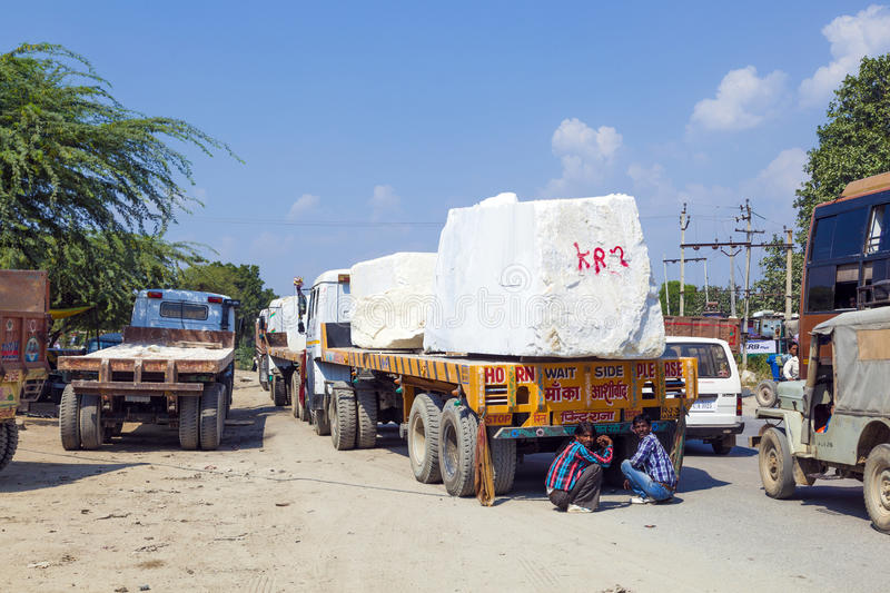 Lorry transports huge marble stones. PADANGANJ, INDIA - OCTOBER 21: lorry transports huge marble stones from the pit on highway 7 to resellers all over india on royalty free stock photos