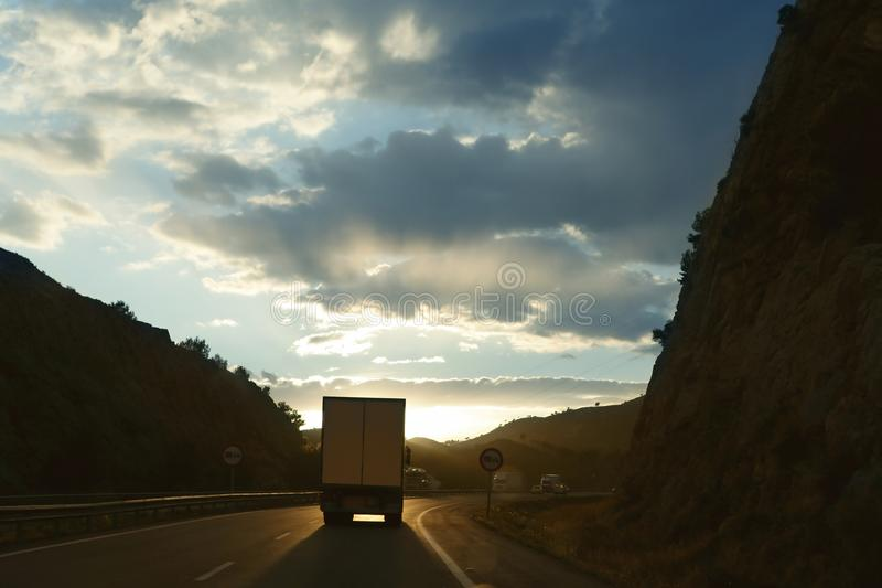 Lorry truck backlight on a golden Europe road royalty free stock photos