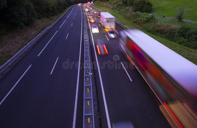 Lorry trucks and cars in traffic jam on the highway at sunset. Basque Country royalty free stock images