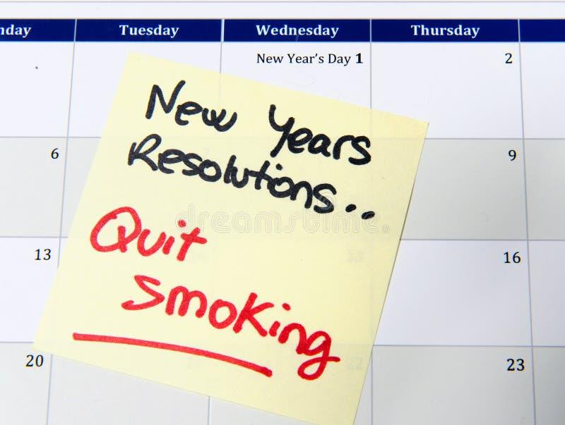 Los Años Nuevos de resolución abandonaron el fumar fotos de archivo