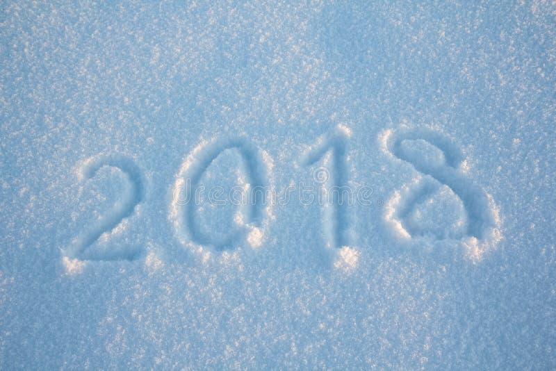 Los Años Nuevos firman 2018, manuscrito en nieve fresca fotografía de archivo