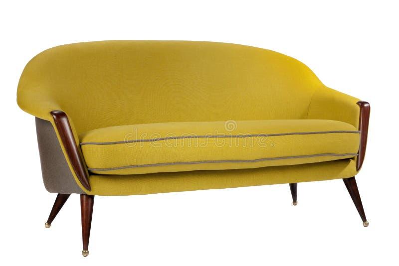 Los años 60 retros del sofá del estilo diseñan color antiguo del amarillo de la mostaza fotos de archivo