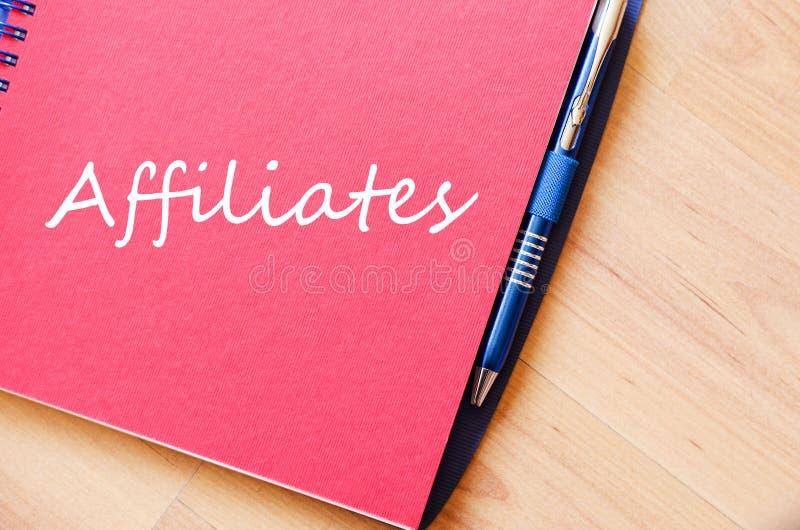 Los afiliados escriben en el cuaderno imagen de archivo