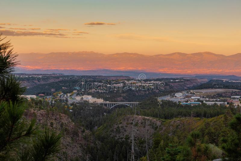 Los Alamos, New Mexico. Town of Los Alamos, New Mexico on the left and center, the Omega Bridge in the middle and the Los Alamos National Laboratories on the stock photography