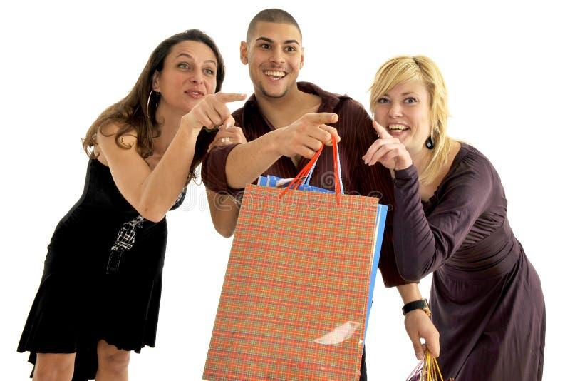 Los amigos van a hacer compras fotos de archivo