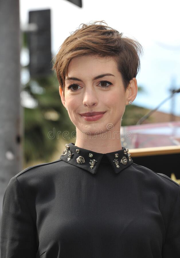 Anne Hathaway. LOS ANGELES, CA - December 13, 2012: Actress Anne Hathaway on Hollywood Blvd where actor Hugh Jackman was honored with the 2,487th star on the royalty free stock photo
