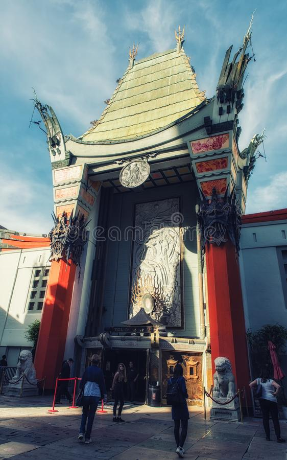 Grauman`s Chinese Theater and visitors. Los Angeles, CA, USA - February 02, 2018: Tourists and other visitors looking at the handprints, footprints, and royalty free stock images