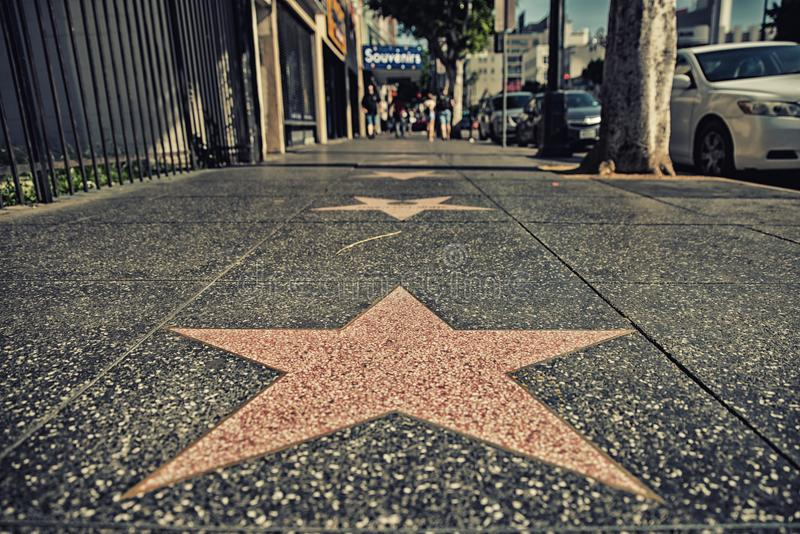 Hollywood Walk of Fame. Los Angeles, CA, USA - February 02, 2018: Walk of Fame at sunset on Hollywood Boulevard. In 1958, the Hollywood Walk of Fame was created royalty free stock photography