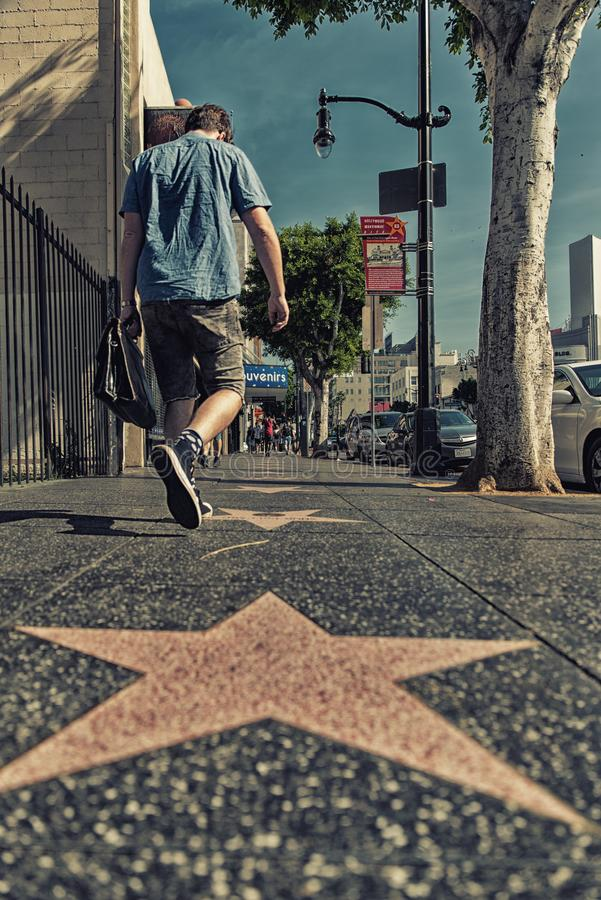 Hollywood Walk of Fame. Los Angeles, CA, USA - February 02, 2018: Walk of Fame at sunset on Hollywood Boulevard. In 1958, the Hollywood Walk of Fame was created stock photography