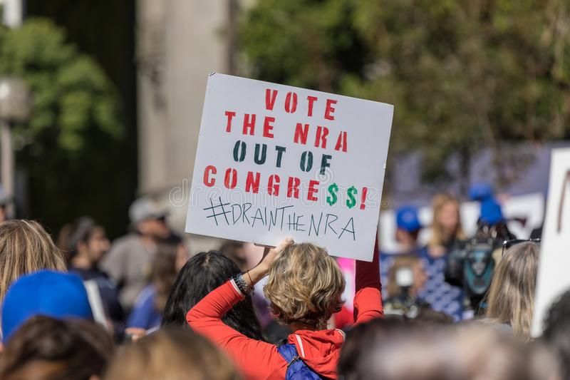 Vote NRA out sign People`s Rally Against Violence royalty free stock photo