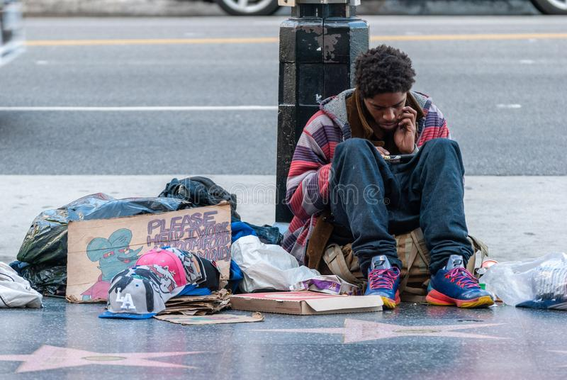 Homeless man on Sunset Boulevard in Los Angeles, CA stock image