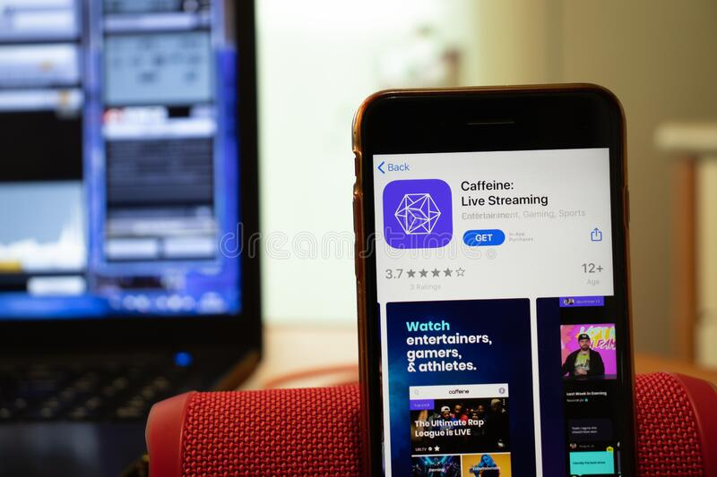 Los Angeles, California, USA - 16 April 2020: Caffeine Live Streaming logo on screen close up. App store icon visible on phone. Display, Illustrative Editorial stock images