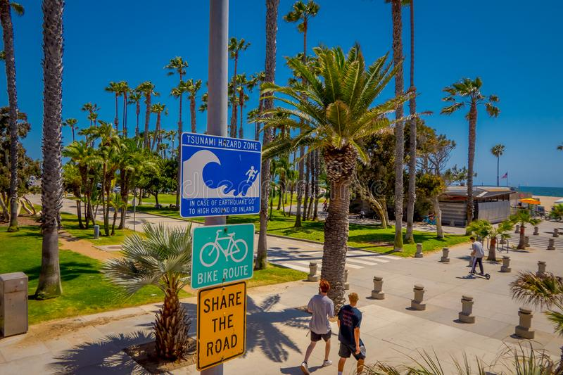 Los Angeles, California, USA, AUGUST, 20, 2018: Outdoor view of informative sign of evacuation route at Venice Beach. California warns that the area is a royalty free stock image