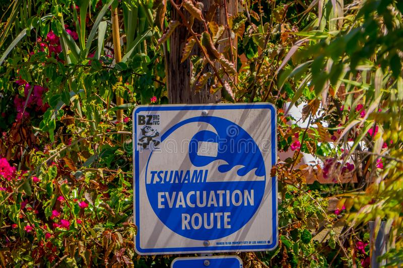 Los Angeles, California, USA, AUGUST, 20, 2018: Outdoor view of informative sign of evacuation route at Venice Beach. California warns that the area is a stock images