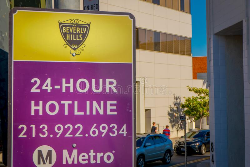 Los Angeles, California, USA, AUGUST, 20, 2018: Outdoor view of informative sign of Metro logo hotline, LA Metro is the royalty free stock image