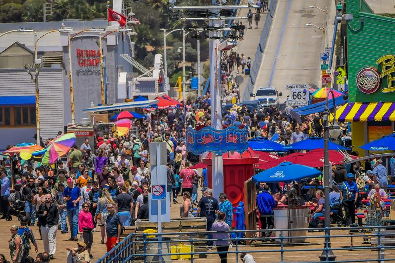 Los Angeles, California, USA, JUNE, 15, 2018: Outdoor view of people walking at the pier of Santa Monica Pier, at the stock photo