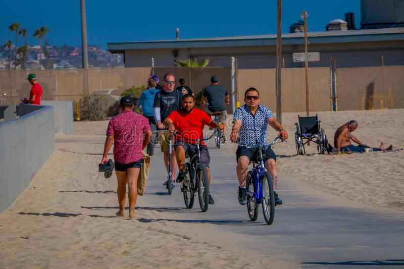 Los Angeles, California, USA, JUNE, 15, 2018: Outdoor view of unidentified people biking in Venice Beach in Santa Monica. Is popular by domestic residents for stock photography