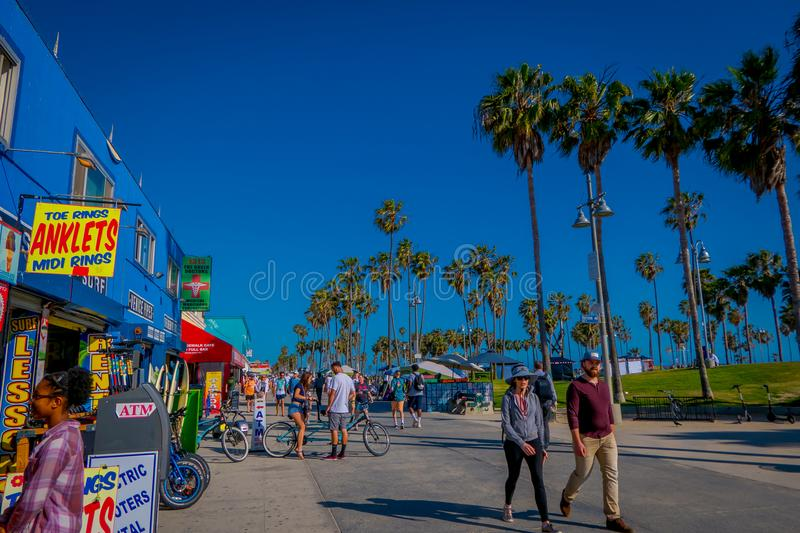 Los Angeles, California, USA, JUNE, 15, 2018: Outdoor view of unidentified people walk along the Venice Beach Boardwalk. On a sunny summer day close to a many royalty free stock images