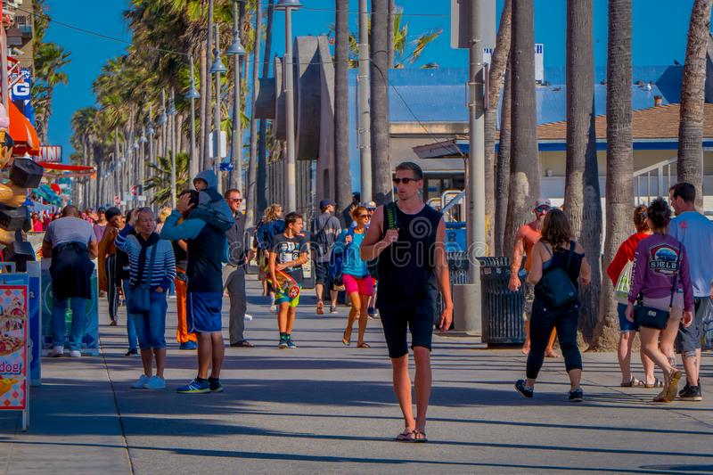 Los Angeles, California, USA, JUNE, 15, 2018: Outdoor view of unidentified people walk along the Venice Beach Boardwalk. On a sunny summer day in L.A stock photography