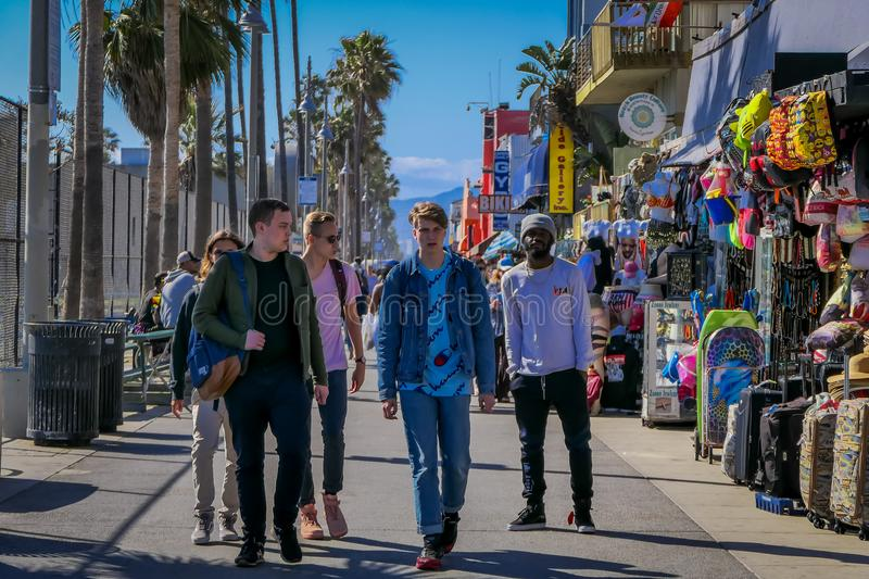 Los Angeles, California, USA, JUNE, 15, 2018: Outdoor view of unidentified people walk along the Venice Beach Boardwalk. On a sunny summer day in L.A stock photo